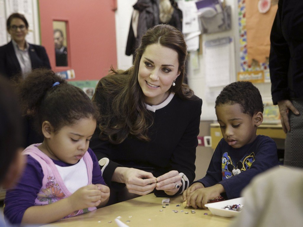 Kate, the Duchess of Cambridge talks to four-year-olds April and Sammy in a pre-school class at the Northside Center for Childhood Development, Monday in New York. AP Photo/Seth Wenig- Pool