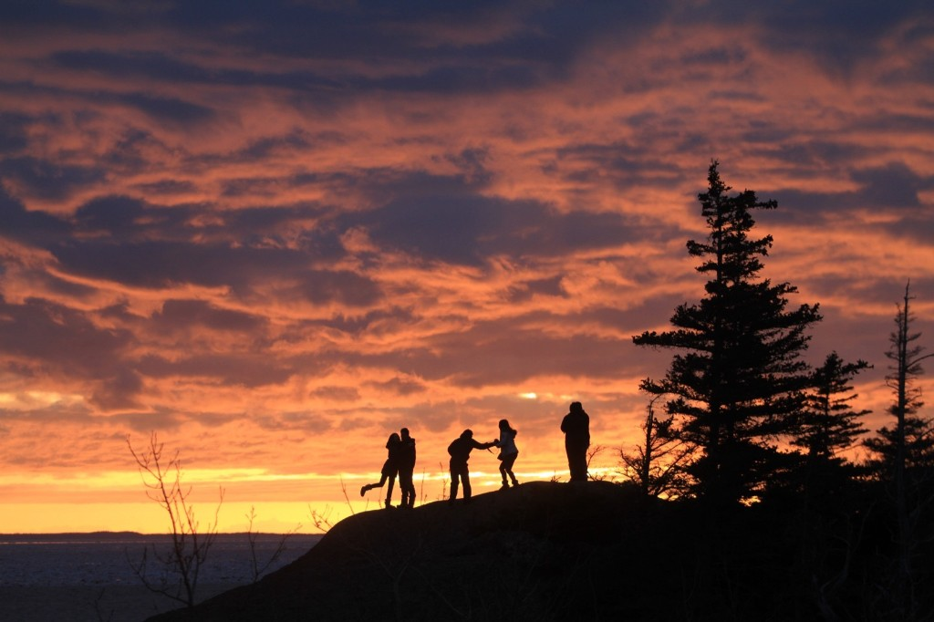 Three couples enjoy the spring equinox sunset over Turnagain Arm in Anchorage. AP Photo/Dan Joling