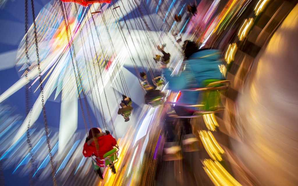 Children ride on a merry-go-round at a Christmas market in Berlin. REUTERS/Hannibal Hanschke
