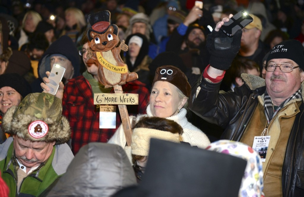 Sharon Adams of Philadelphia cheers for six more weeks of winter prior to Phil's annual weather prediction on the 130th Groundhog Day in Punxsutawney, Pa. REUTERS/Alan Freed