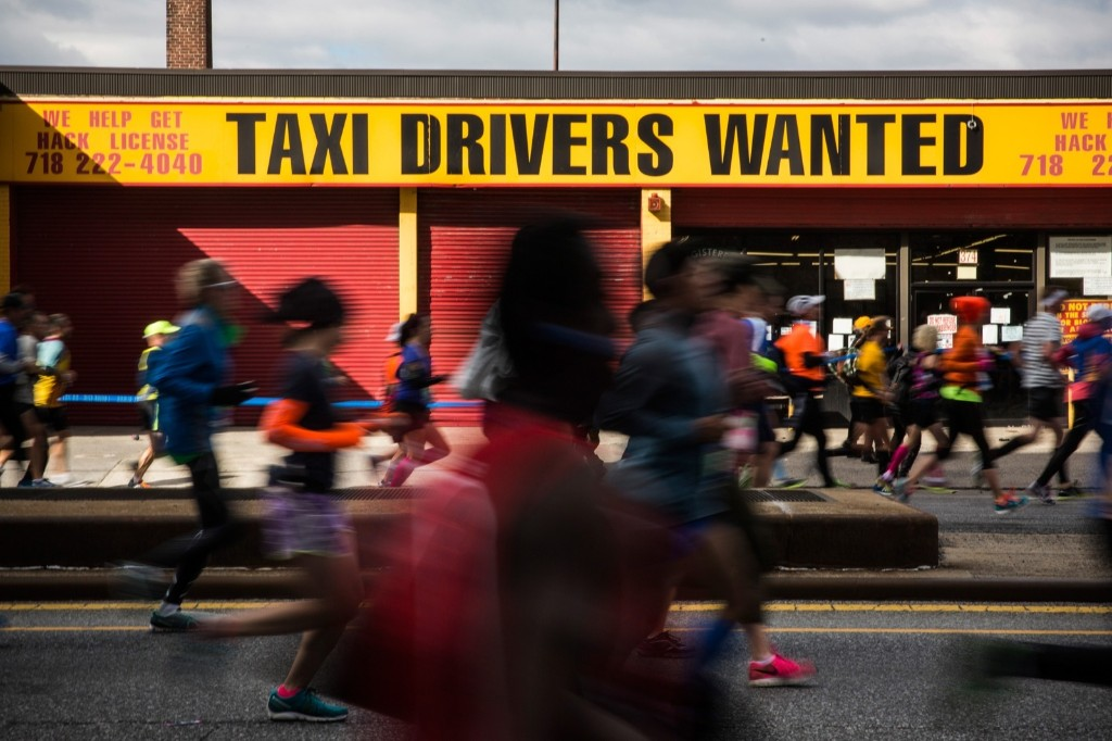 Runners pass a taxi depot in Park Slope. Andrew Burton/Getty Images