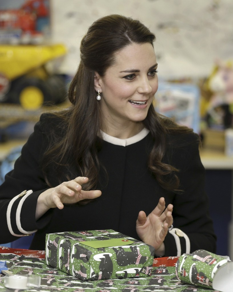 Kate, the Duchess of Cambridge wraps presents for children at the Northside Center for Childhood Development, Monday in New York. AP Photo/Seth Wenig-Pool