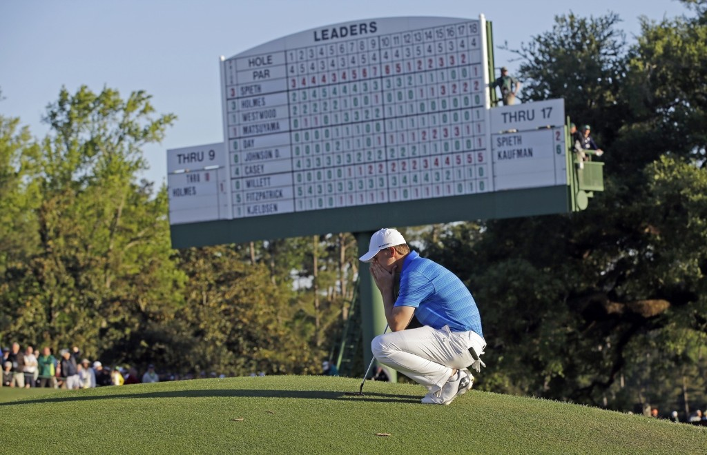 Jordan Spieth waits to putt at the 18th green during the final round of the Masters golf tournament. He blew a five stroke lead on the back nine to finish second. AP Photo/David J. Phillip
