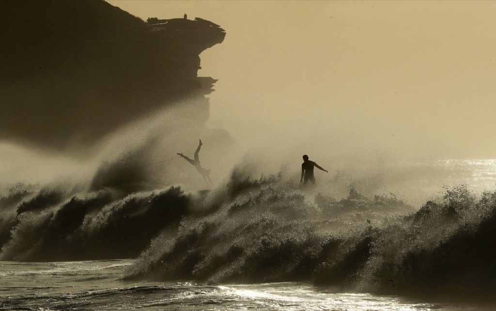 Surfers take advantage of a large swell at Bronte Beach in Sydney. Mark Evans/Getty Images