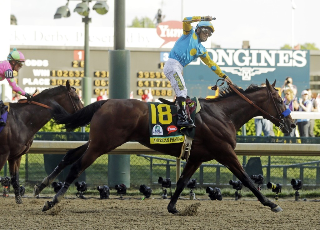 Victor Espinoza rides American Pharoah to victory in the 141st running of the Kentucky Derby, at Churchill Downs, Saturday, in Louisville. AP Photo/Morry Gash