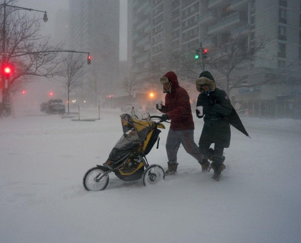 Sean Jackson and Gina Del Tatto push their child, Hayes Jackson, in a stroller as heavy snow falls on New York's Upper West Side, Saturday morning. AP Photo/Craig Ruttle