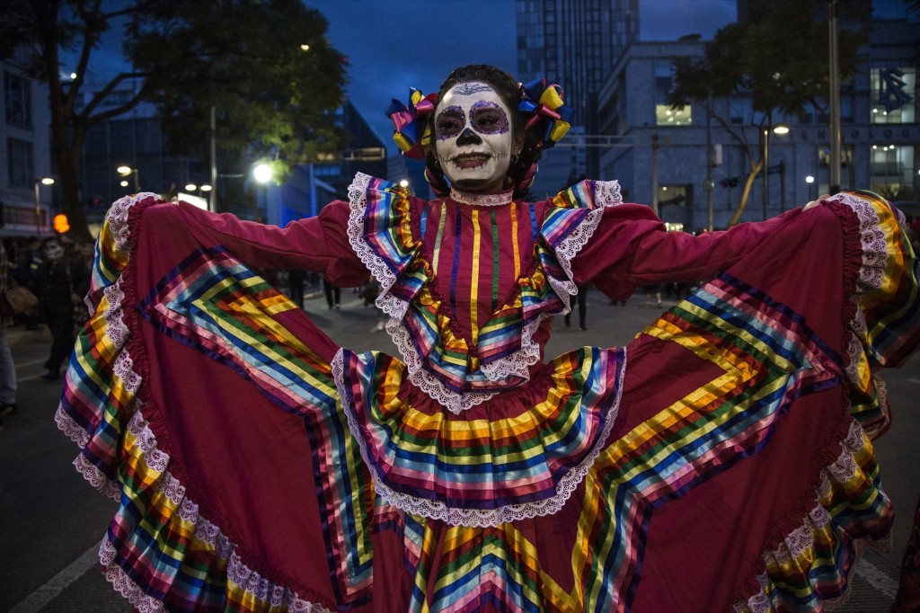 Hundreds of people dressed as Catrinas walked through Paseo de la Reforma, the most important avenue in Mexico City. Cristopher Rogel Blanquet/Getty Images