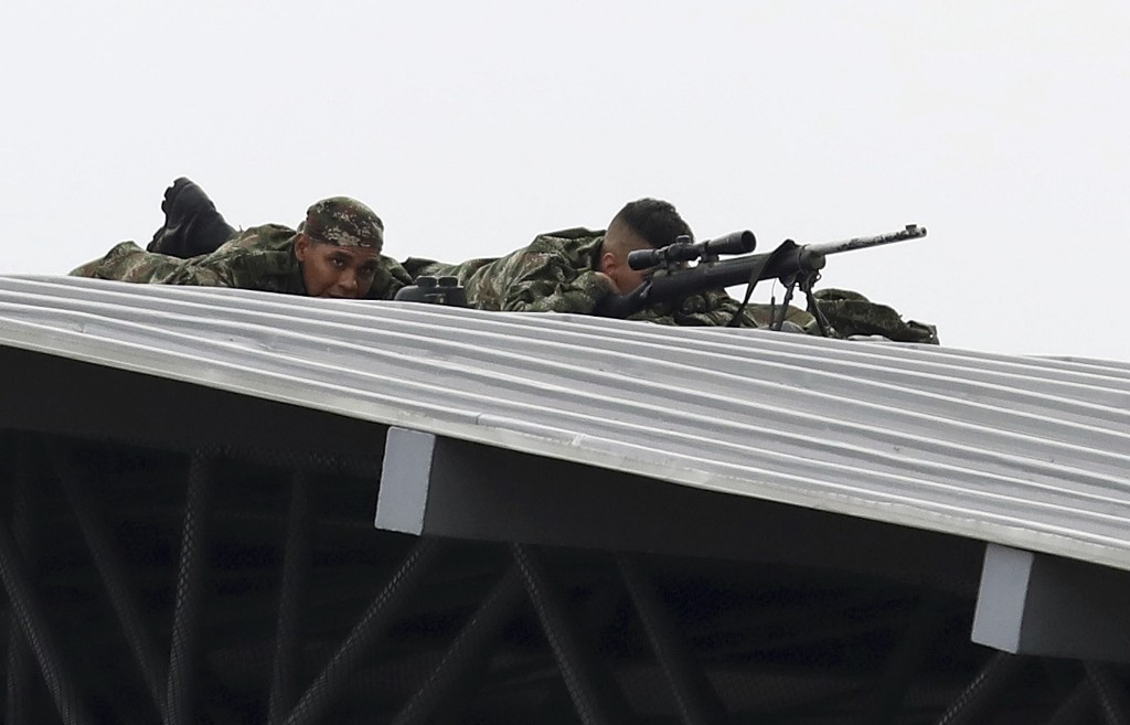 Colombian Army snipers cover the Venezuela Aid Live concert on the Colombian side of the Tienditas International Bridge near Cucuta, Colombia, on the border with Venezuela, Friday, Feb. 22, 2019. (AP Photo/Fernando Vergara)