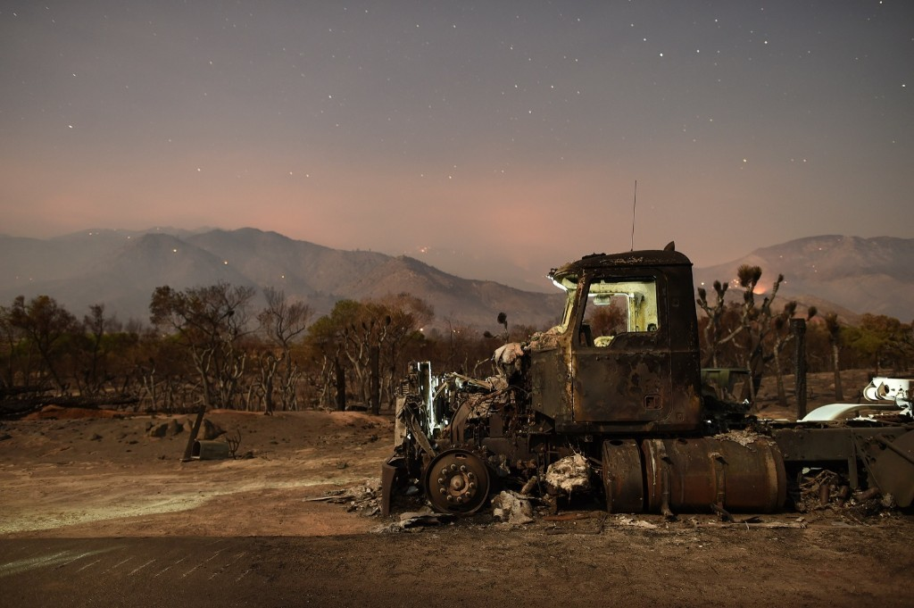 A burned out truck rests on a roadside after the Erskine Fire burned through Weldon, Calif. REUTERS/Noah Berger