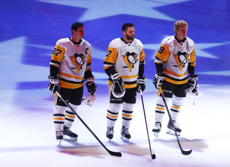 Jan 18, 2019; Glendale, AZ, USA; Pittsburgh Penguins center Sidney Crosby (87), right wing Bryan Rust (17) and center Jake Guentzel (59) stand on the ice for the national anthem prior to the game against the Arizona Coyotes at Gila River Arena. Mandatory Credit: Mark J. Rebilas-USA TODAY Sports