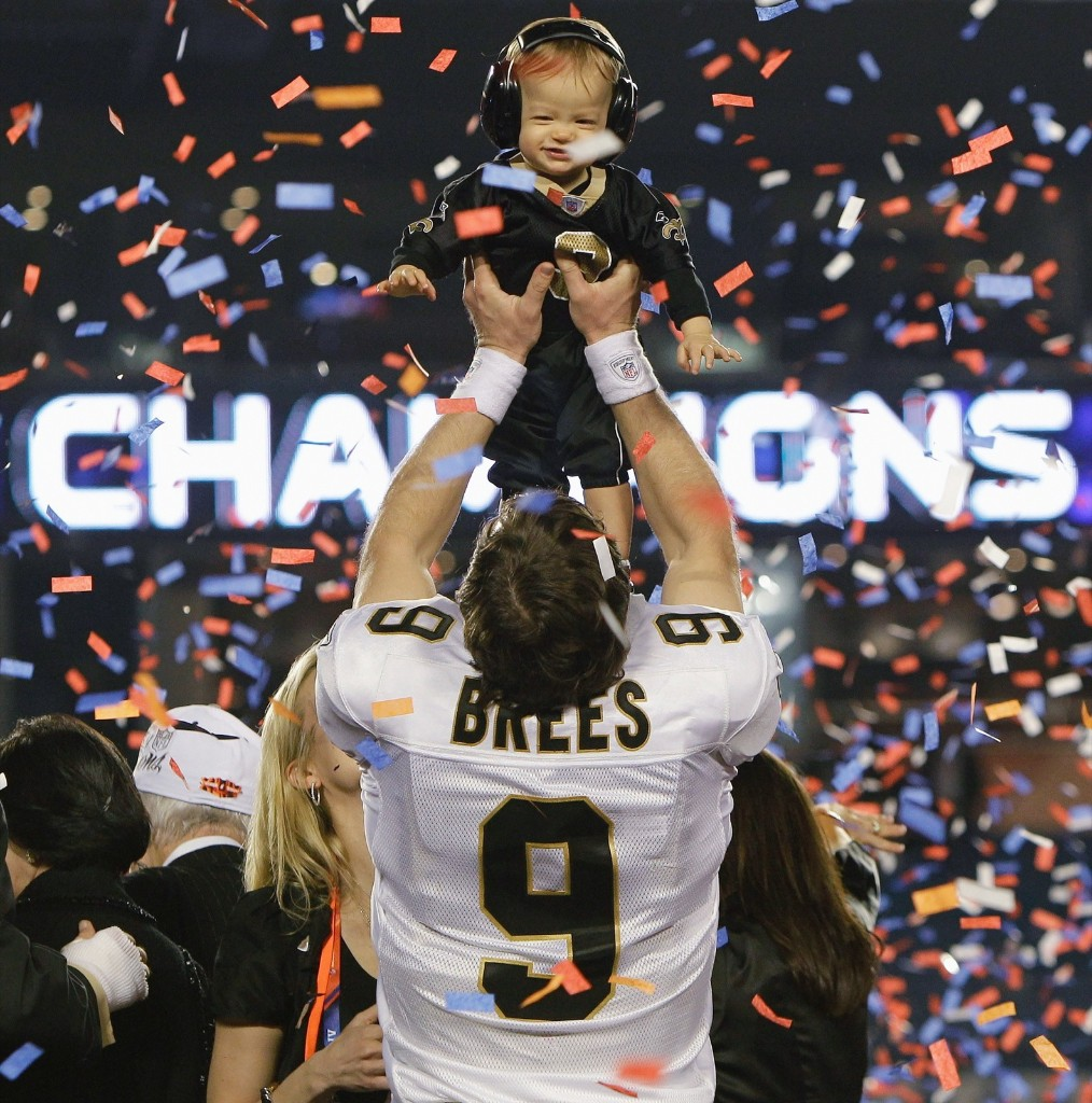 Saints quarterback and MVP Drew Brees holds his son Baylen after defeating the Colts, 31-17, in Super Bowl XLIV, Feb. 2010 , in Miami. AP Photo/Eric Gay