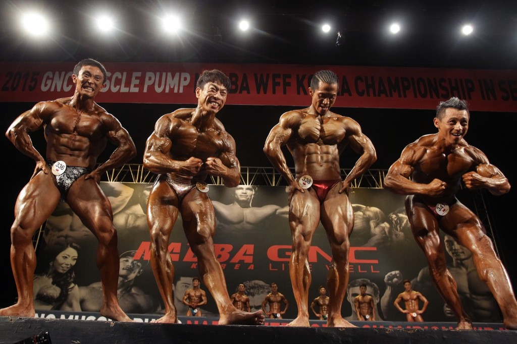 Contestants pose for judges during the National Amateur Body-Builders Association and World Fitness Federation Korea Championship in Seoul. Chung Sung-Jun/Getty Images