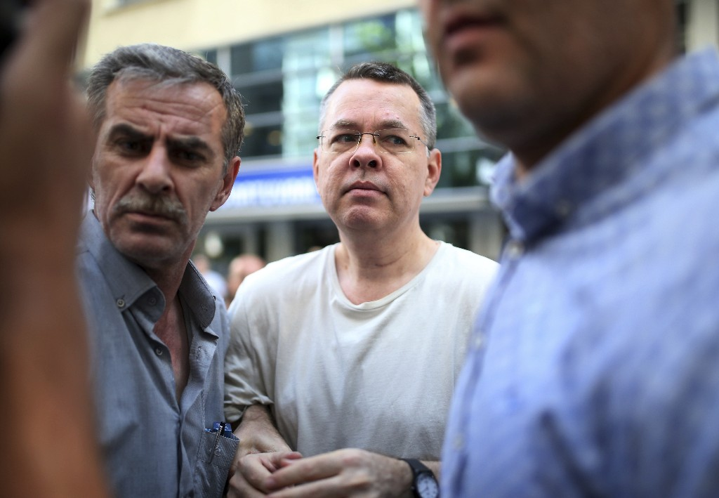 In this July 25, 2018 photo, Andrew Craig Brunson, an evangelical pastor from Black Mountain, North Carolina, arrives at his house in Izmir, Turkey. Brunson, who had been jailed in Turkey for more than one and a half years on terror and espionage charges was released and will be put under house arrest as his trial continues. The White House is announcing that the Treasury Department is imposing sanctions on two Turkish officials over a detained American pastor who is being tried on espionage and terror-related charges. (AP Photo/Emre Tazegul)