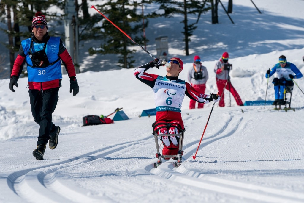 Ethan Hess of Canada during the Cross-Country Skiing Sitting Men's 15km. Bob Martin for OIS/IOC