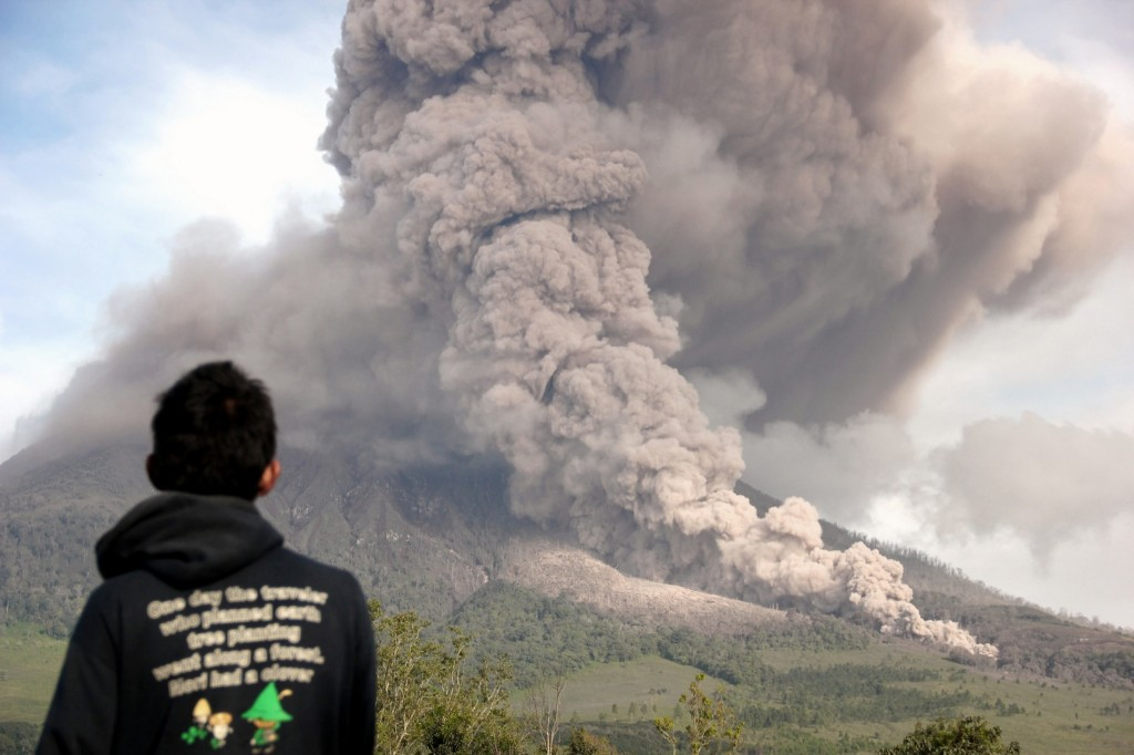Mount Sinabung spews ash and gas in Tiga Pancur, North Sumatra, Indonesia, Wednesday. The 2,600-meter volcano has erupted sporadically since September. AP Photo/Dedy Zulkifli