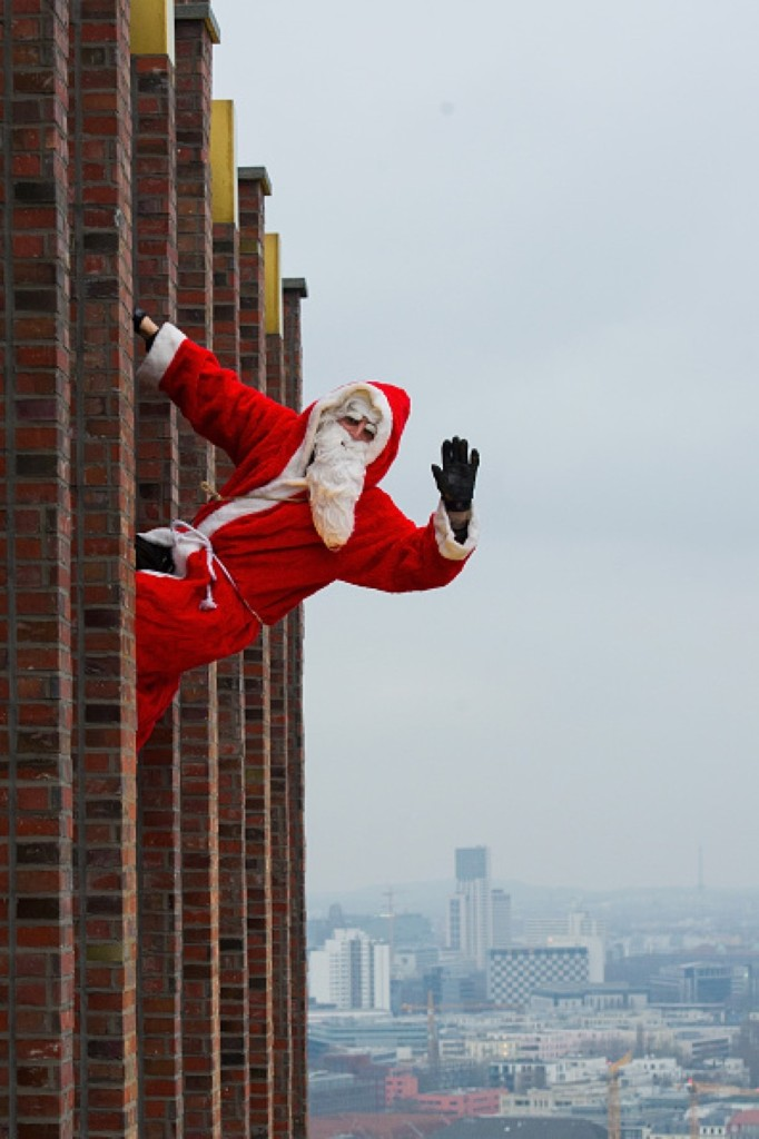 Santa Claus waves from the Kollhoff Tower ahead of an acrobatic dance show in Berlin. Target Presse Agentur Gmbh/Getty Images