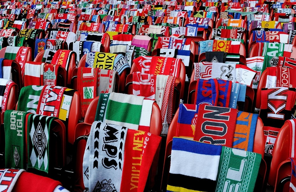 Scarves donated by fans of Liverpool are placed on empty seats during memorial service marking the 25th anniversary of the Hillsborough disaster, at Anfield Stadium. Liverpool FC via Getty Images
