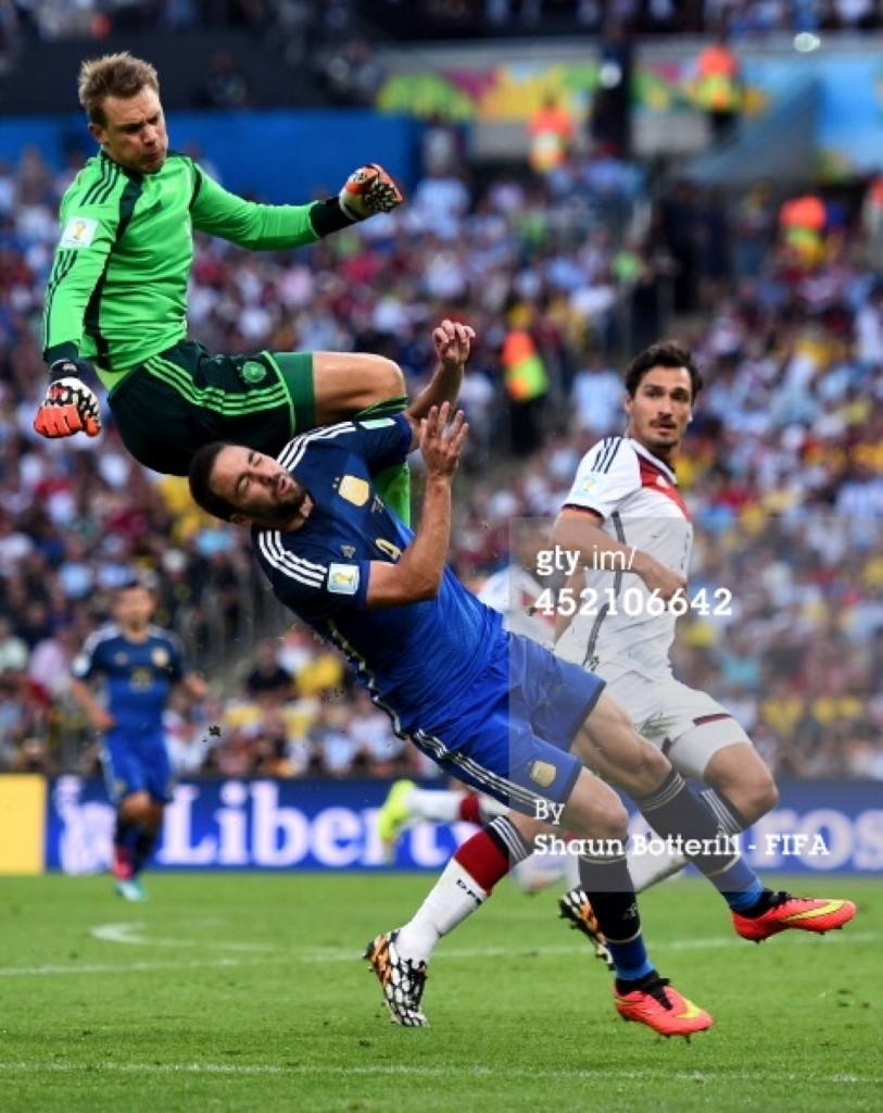 Gonzalo Higuain of Argentina and Manuel Neuer of Germany collide. Shaun Botterill/FIFA/Getty Images