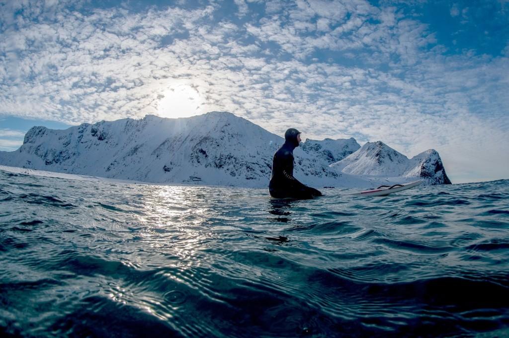 Surfering in the Arctic Circle. Ocean temp 6-7°C, air temp 0°C. Olivier Morin/AFP/Getty Images