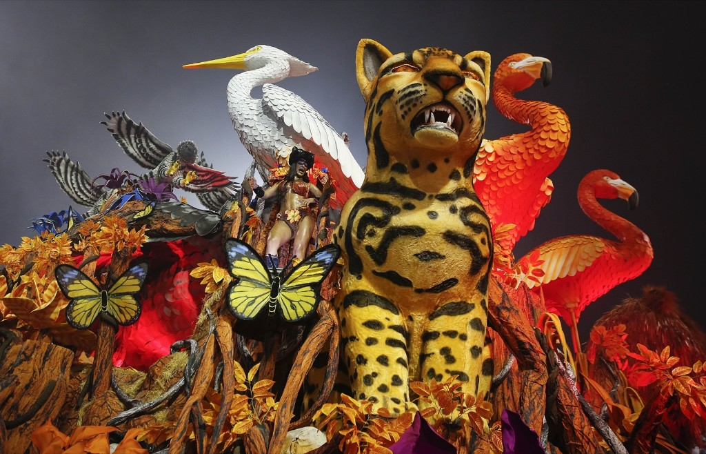 A dancer from the Gavioes da Fiel samba school performs on a float during a carnival parade in Sao Paulo. AP Photo/Andre Penner