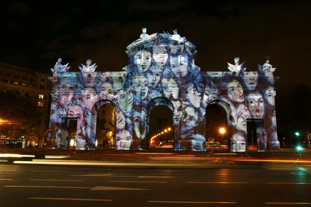 An image commemorating the former Berlin Wall is projected on the Alcala Gate in Madrid. REUTERS/Juan Medina
