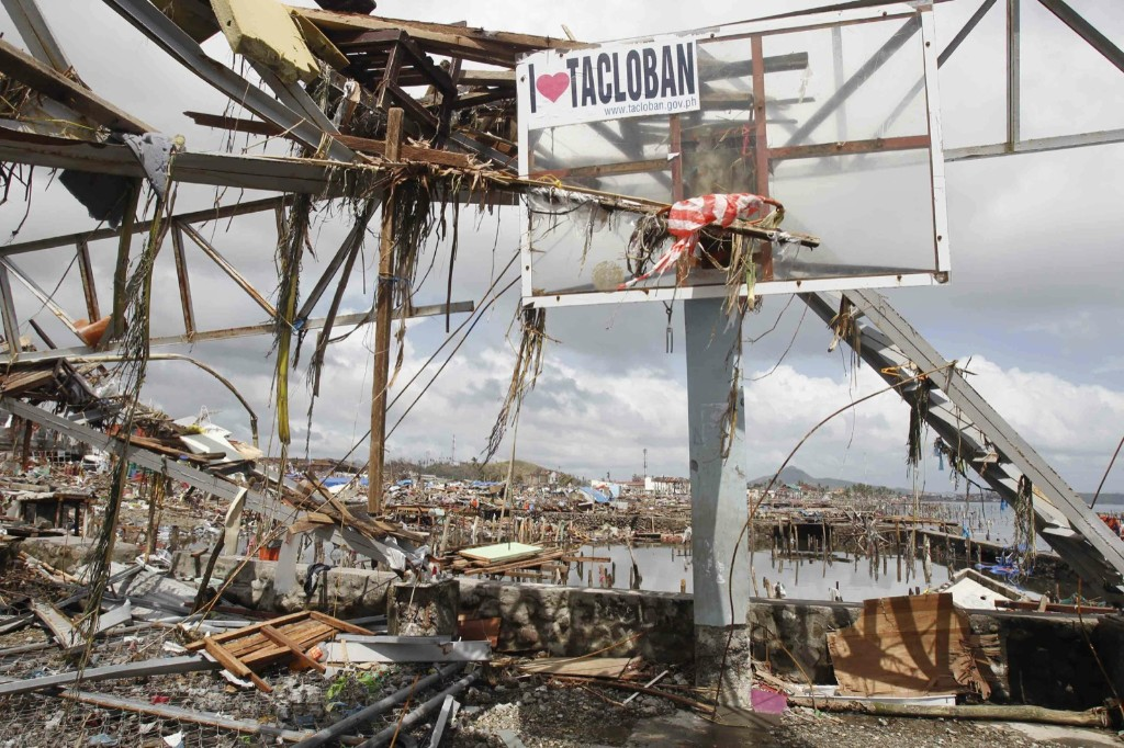 Debris hang on a basketball post near thousands of houses damaged after super Typhoon Haiyan battered Tacloban. REUTERS/Romeo Ranoco