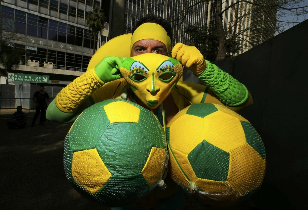 A Brazil fan puts on his costume before watching telecast of match between Brazil and Chile in Sao Paulo. REUTERS/Ivan Alvarado