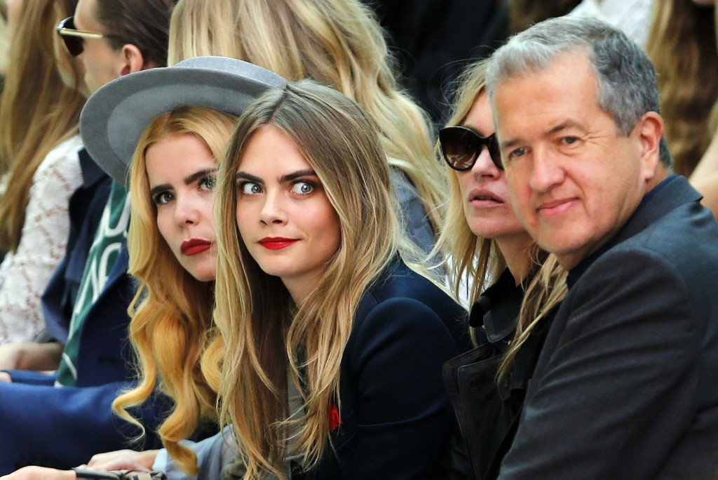 Paloma Faith, Cara Delevingne, Kate Moss and photographer Mario Testino watch the presentation of the Burberry Prorsum Spring/Summer 2015 collection. REUTERS/Suzanne Plunkett