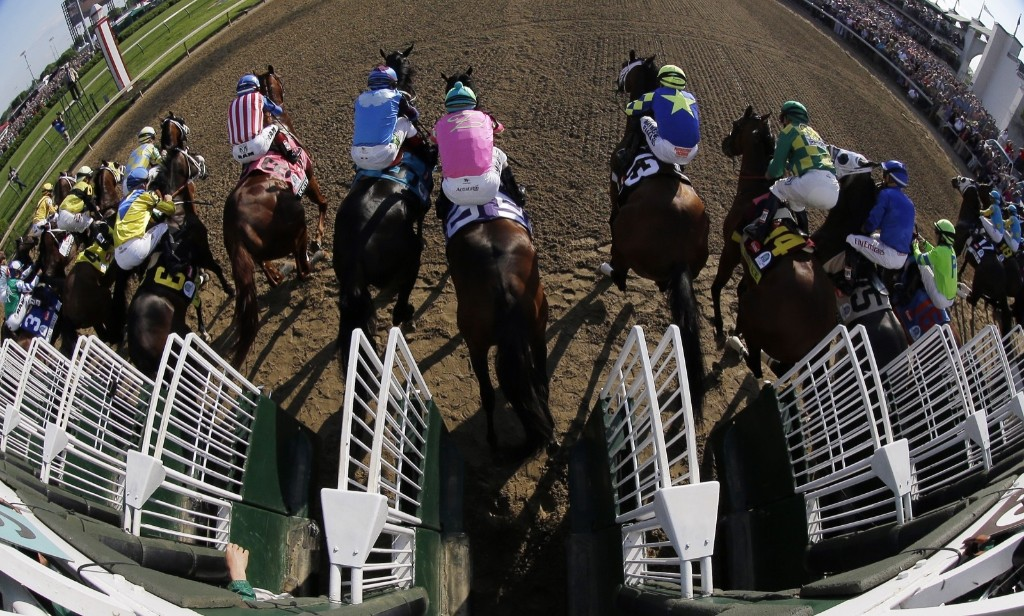 Horses leave the starting gate during the 141st running of the Kentucky Derby horse race, at Churchill Downs, Saturday, in Louisville. AP Photo/Matt Slocum