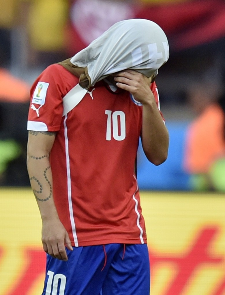 Chile's Jorge Valdivia after a missed penalty shot. AP Photo/Martin Meissner