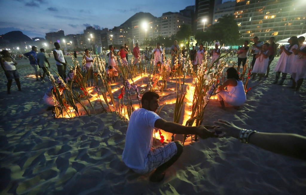 The faithful gather for a ceremony honoring Iemanja, Goddess of the Sea, as part of traditional New Year's celebrations on Copacabana beach in Rio. Mario Tama/Getty Images