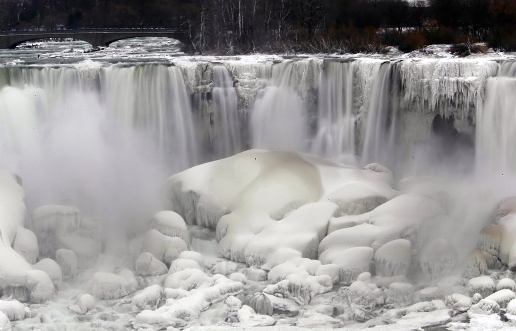 """The U.S. side of Niagara Falls after being partially frozen from a """"polar vortex"""" that affected millions in the U.S. and Canada in January 2014. AP Photo/Nick LoVerde"""