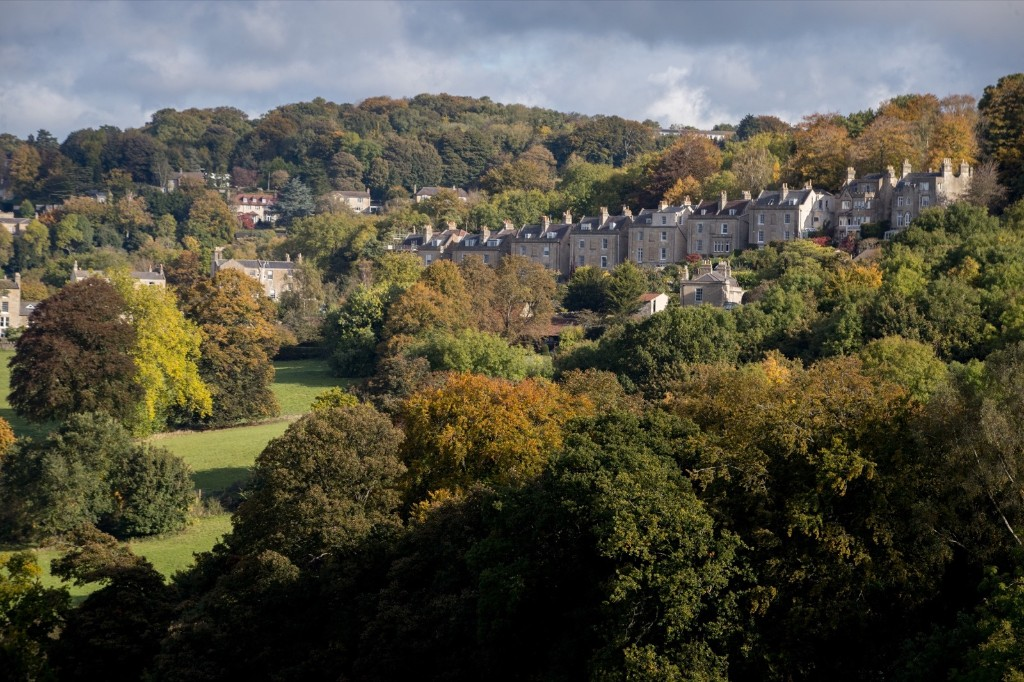 The sun shines on trees that are beginning to show their autumn colours in Prior Park in Bath, England. Matt Cardy/Getty Images