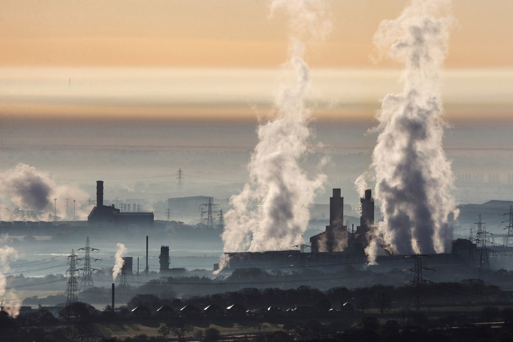 The industrial landscape across the Dee Estuary at sunrise as steam rises from Deeside power station, Shotton Steelworks and other heavy industrial plants in Flint, Wales. Christopher Furlong/Getty Images