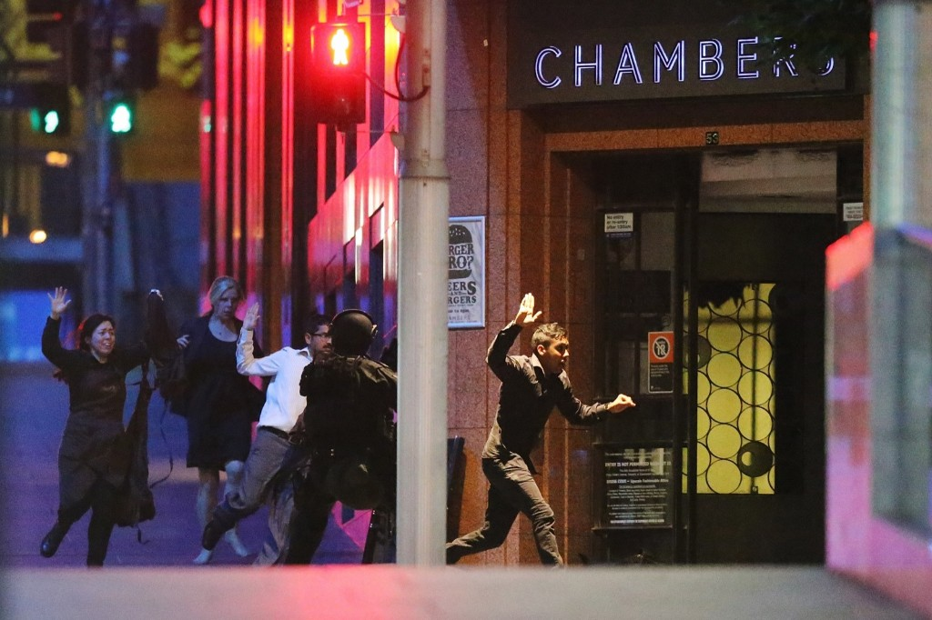 People run from the Lindt Cafe during a hostage standoff in Sydney. Joosep Martinson/Getty Images
