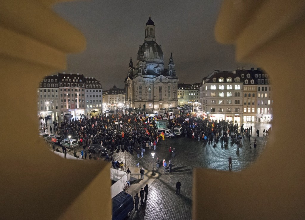 A rally called 'Patriotic Europeans against the Islamization of the West', with a view of the Frauenkirche cathedral, in Dresden. AP Photo/Jens Meyer