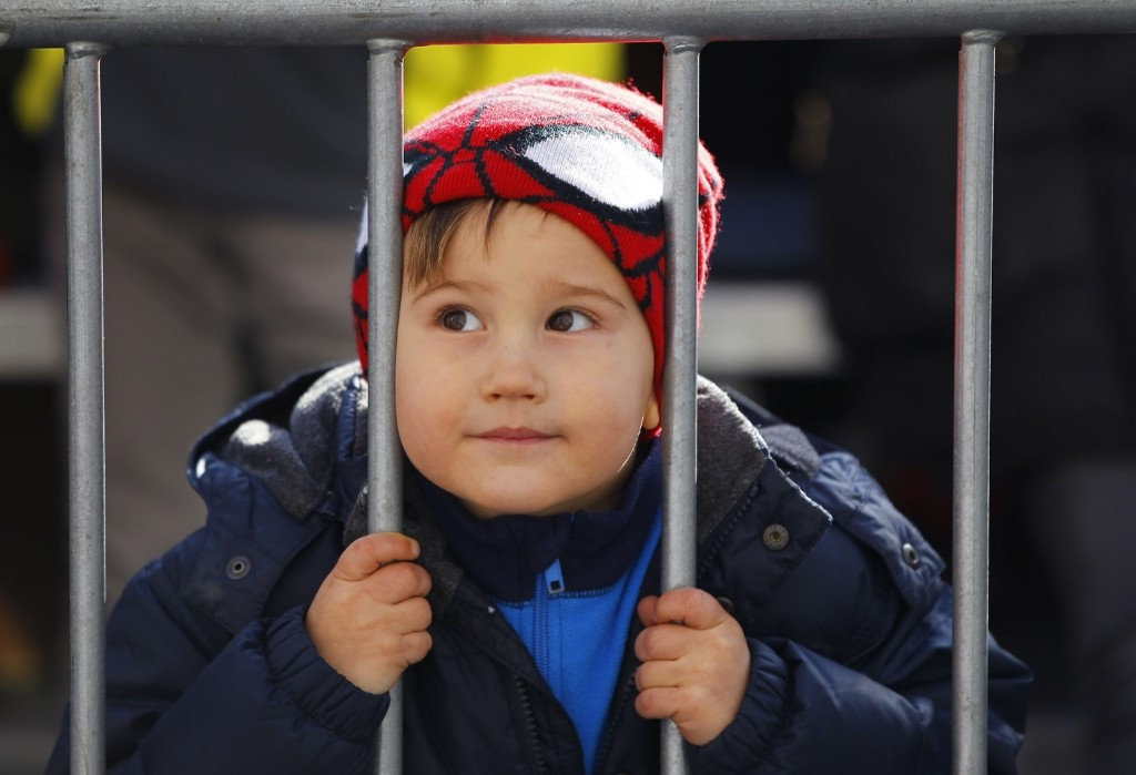 A boy watches the Macy's Thanksgiving Day Parade on Central Park West in New York, Thursday. Photo by Gary Hershorn