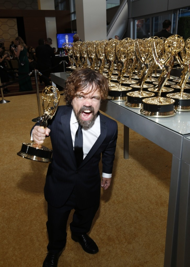 "Peter Dinklage, winner of the award for outstanding supporting actor in a drama series for ""Game of Thrones,"" attends the 70th Primetime Emmy Awards in Los Angeles. Eric Jamison/Invision for the Television Academy/AP Images"