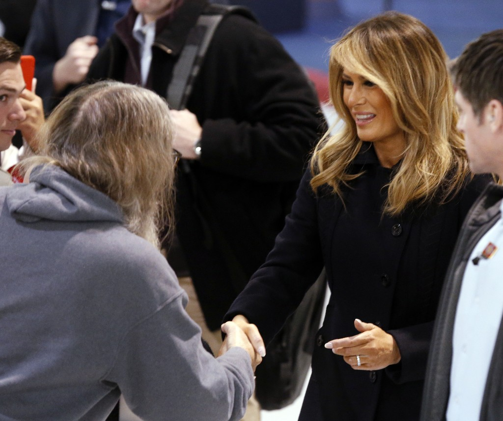 First Lady Melania Trump, right, greets members of the crowd during a tour of Joint Base Langley in Hampton, Va., Wednesday, Dec. 12, 2018. (AP Photo/Steve Helber)