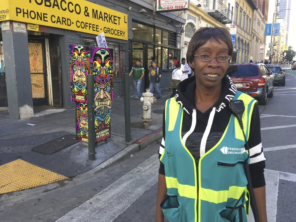 In this photo taken Oct. 5, 2018, San Francisco native Tracey Mixon stands on a street in the Tenderloin district of San Francisco. Mixon, 47, and her daughter were recently evicted from their two-bedroom home. She hopes San Francisco voters will approve Proposition C on the Nov. 6 ballot, which would levy an extra tax on some businesses to raise $300 million a year for homelessness and mental health services. (AP Photo/Janie Har)