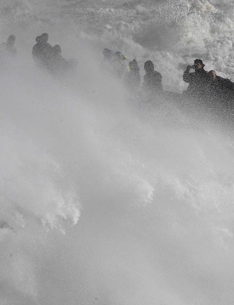 Large waves crash along sea defenses and the harbor as storm Ophelia approaches Porthleven in Cornwall, southwest Britain. REUTERS/Toby Melville