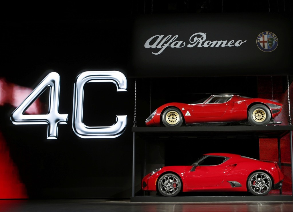 A 2015 Alfa Romeo 4C is displayed along with a 1967 Alfa Romeo 33 Stradale at the North American International Auto Show in Detroit, Monday. REUTERS/Rebecca Cook