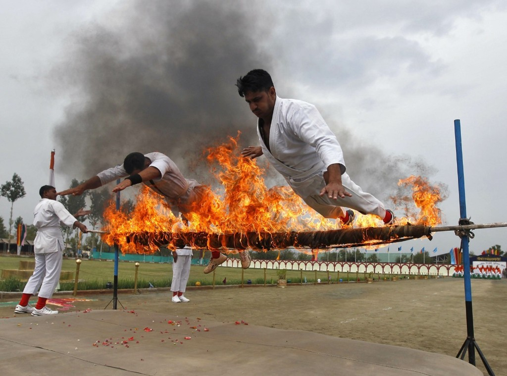 India's Central Reserve Police Force perform a stunt during parade in Humhama. REUTERS/Danish Ismail