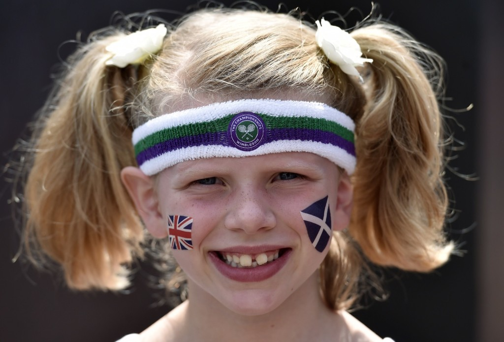 Andy Murray fan, Xanthie, 8, at Wimbledon. REUTERS/Toby Melville