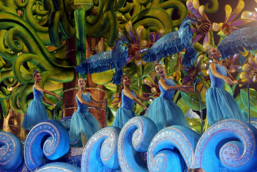Revllers parade for Perola, Negra samba school during carnival in Sao Paulo. REUTERS/Paulo Whitaker