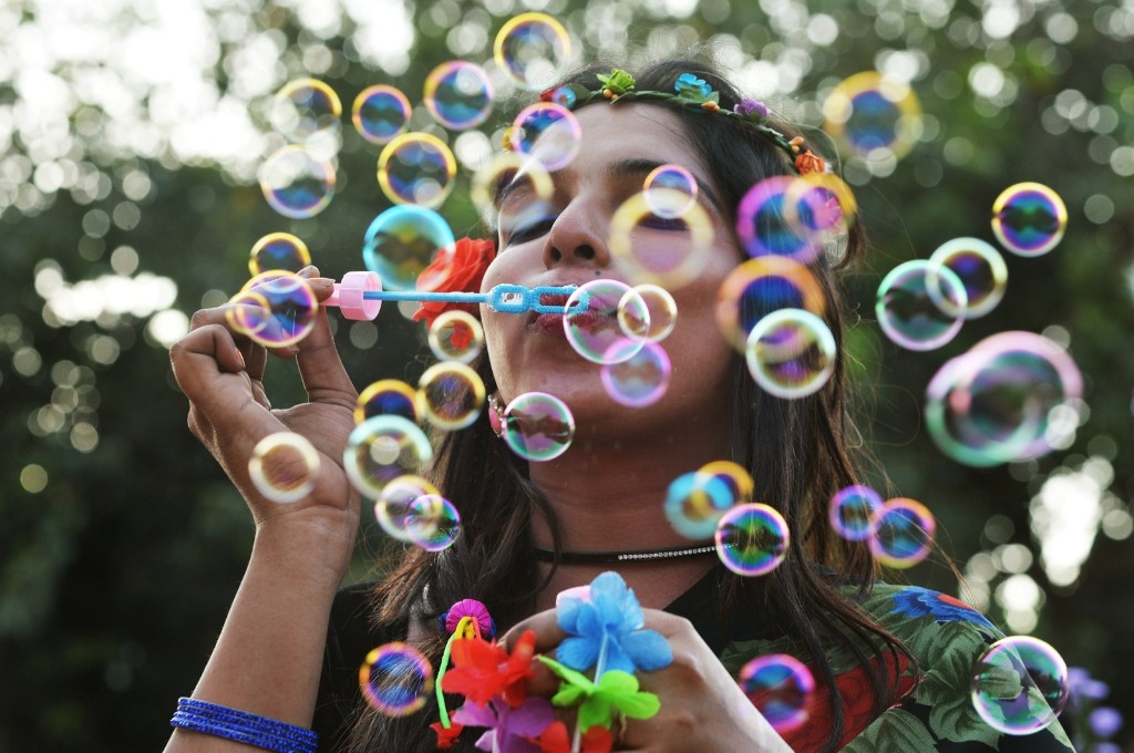 An Indian transgender activist blows bubbles during the annual Bengaluru Pride March in Bangalore. Manjunath Kiran/AFP/Getty Images