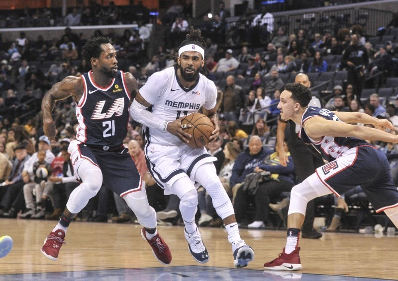 Feb 22, 2019; Memphis, TN, USA; Memphis Grizzlies guard Mike Conley (11) dribbles the ball around LA Clippers guard Patrick Beverley (21) during the first half at FedExForum. Mandatory Credit: Justin Ford-USA TODAY Sports