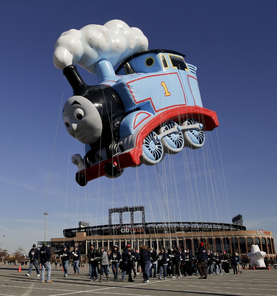 Handlers steer the Thomas the Tank Engine balloon through the CitiField parking lot during practice run for Macy's Thanksgiving Day Parade. AP Photo/Julie Jacobson