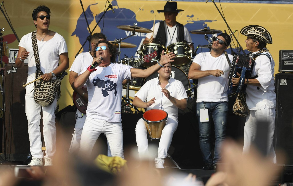 """Carlos Vives performs at the """"Live Aid Venezuela"""" concert at the Tienditas International Bridge on the outskirts of Cucuta, Colombia, Friday, Feb. 22, 2019, on the border with Venezuela. British billionaire Richard Branson organized the mega concert, which features dozens of Latin musicians performing on a giant stage on one side of what Colombian authorities have renamed the """"Unity"""" bridge. (AP Photo/Fernando Vergara)"""