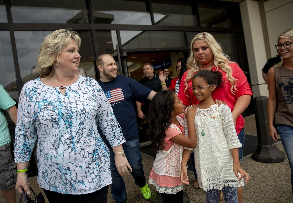 FILE - In this May 28, 2018, file photo, Laurie Holt, left, walks out of the airport with her son, Josh Holt, walking behind her, after returning to Salt Lake City after Josh and his family received medical care and visited President Donald Trump in Washington. Laurie Holt, a Utah woman who spent nearly two years pushing to get her son freed from a Venezuelan jail, has died at age 50. (AP Photo/Kim Raff, File)